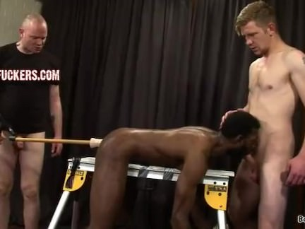 black gay tied to bench